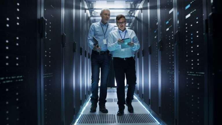 Employees walking inside a data storage room