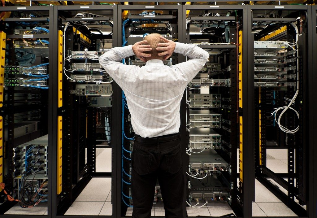 Shocked employee looking at the network data center