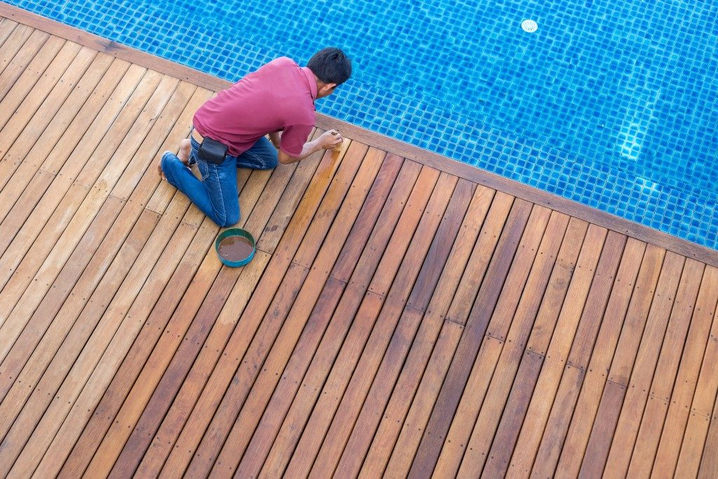 Man cleaning patio