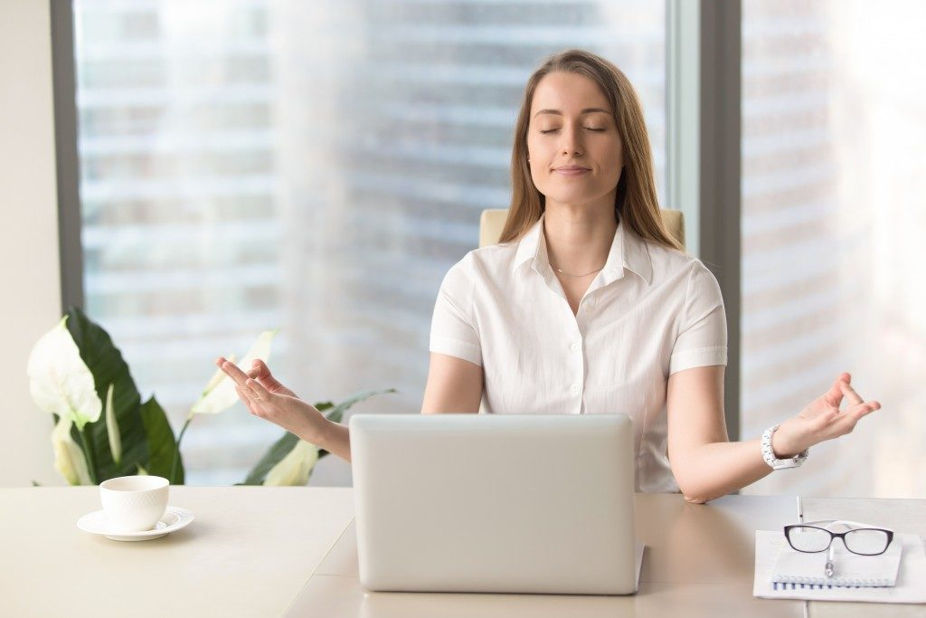 woman meditating at work
