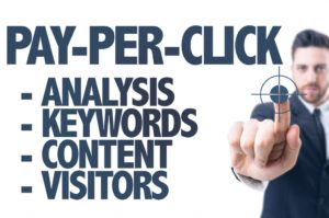Business man pointing the text: Pay-Per-Click