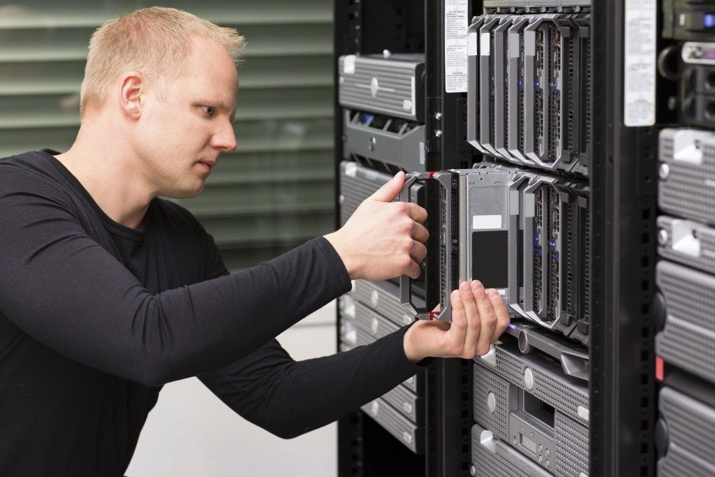 man setting data backup server