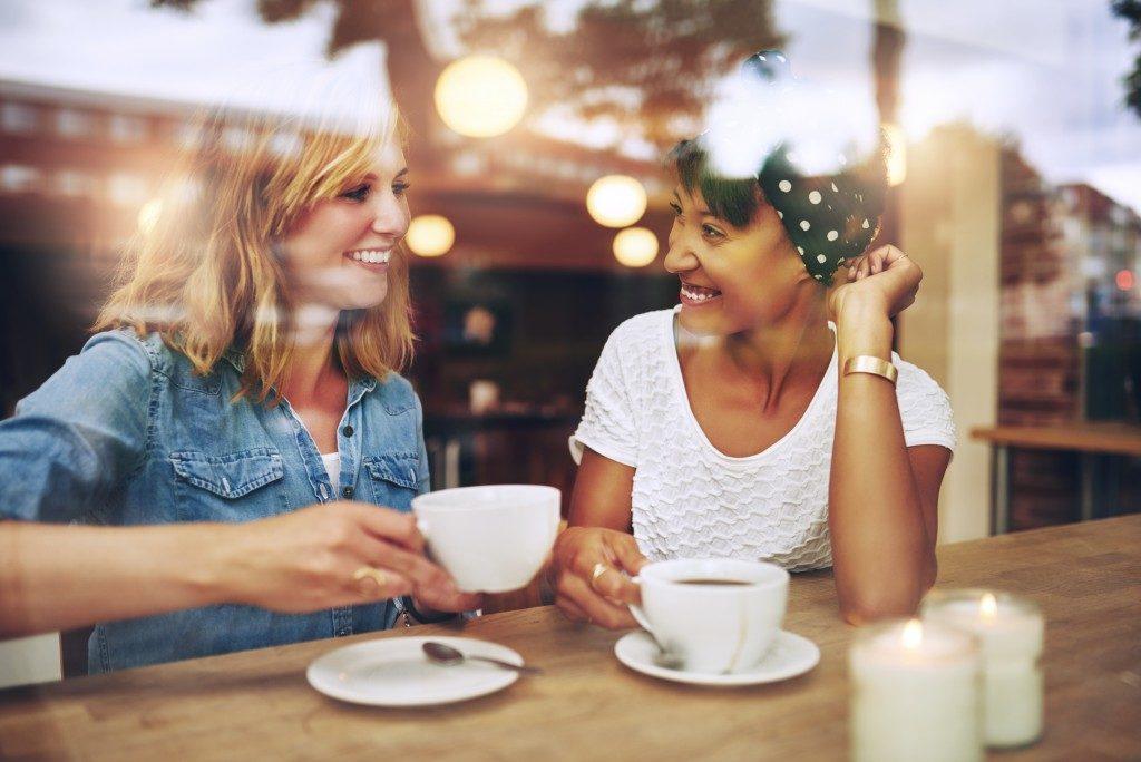 Friends talking drinking coffee
