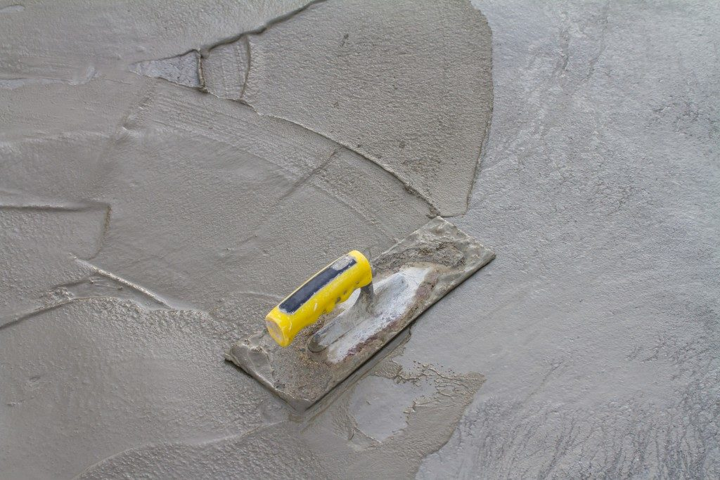 concrete mix being applied to a wall