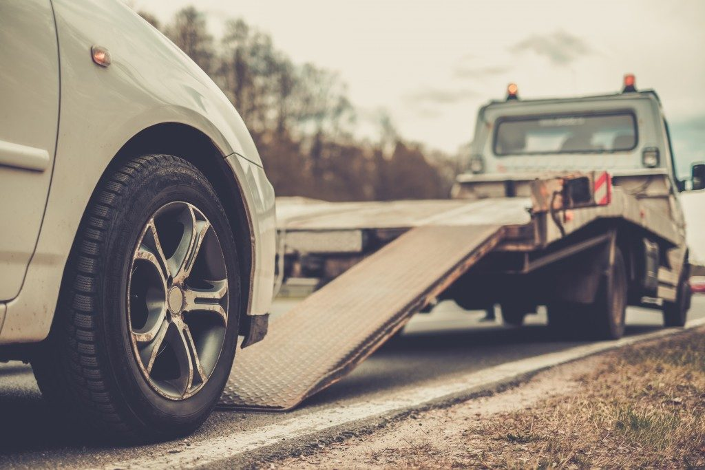 car and a flatbed trailer