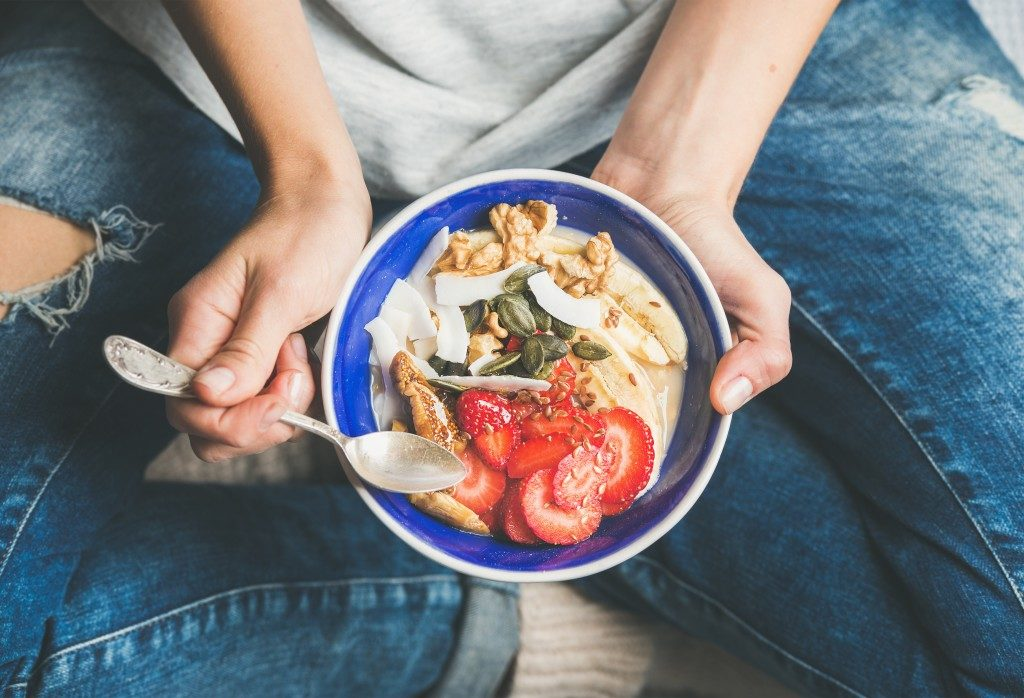 person holding a plate with vegetables