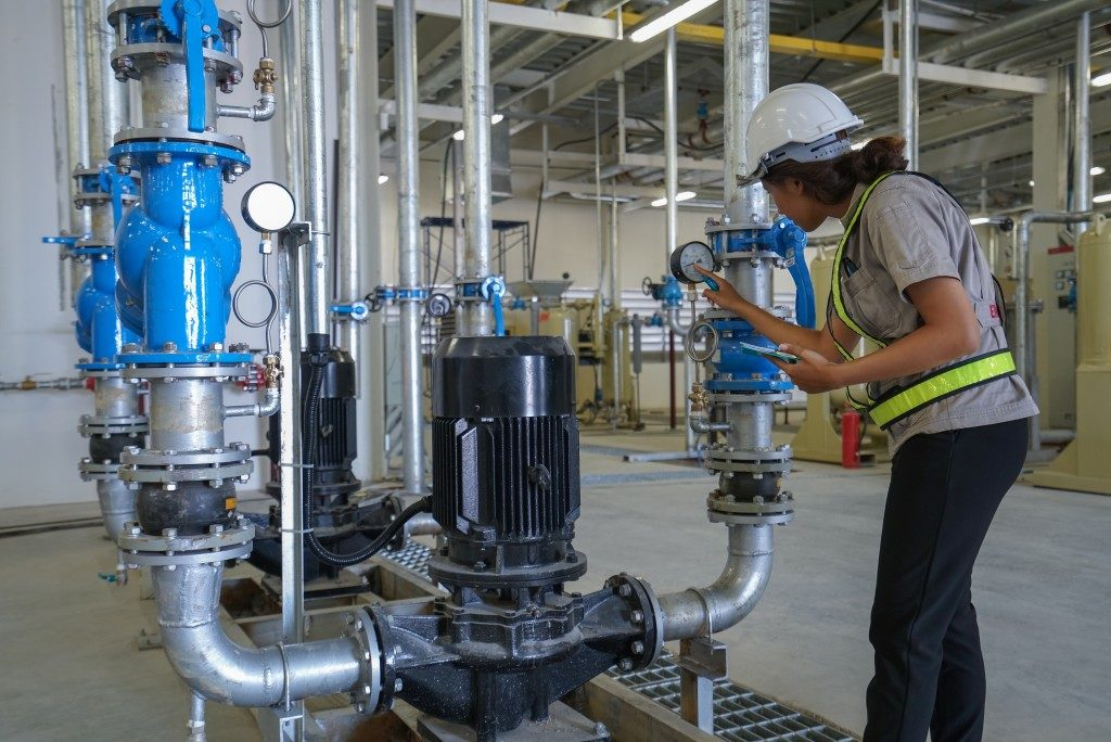 woman checking the piping systems