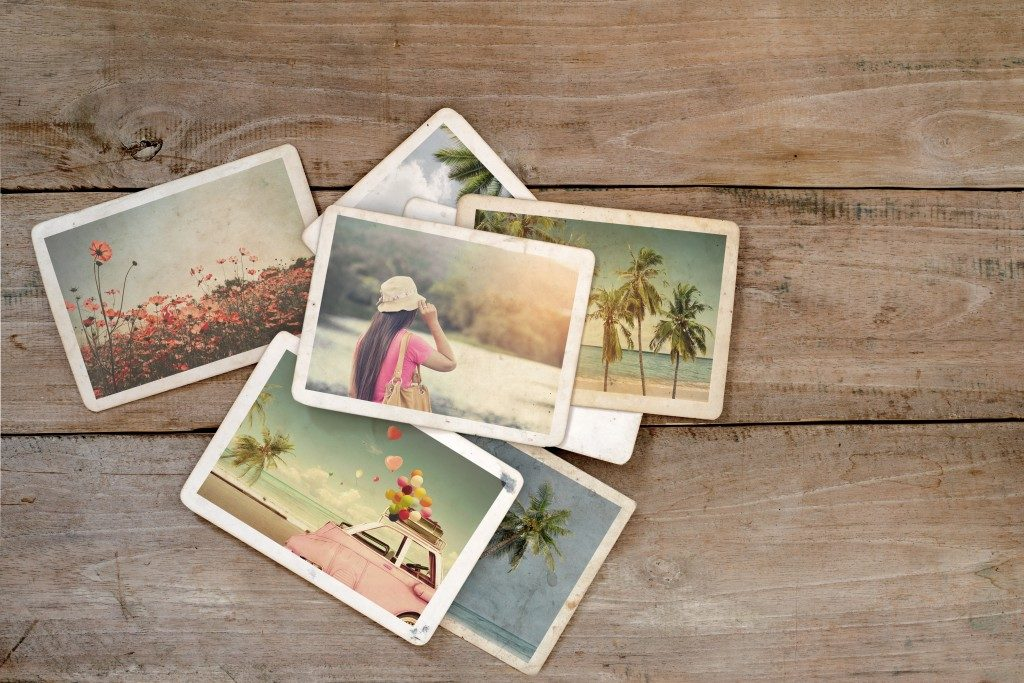Vintage photos on a wooden surface