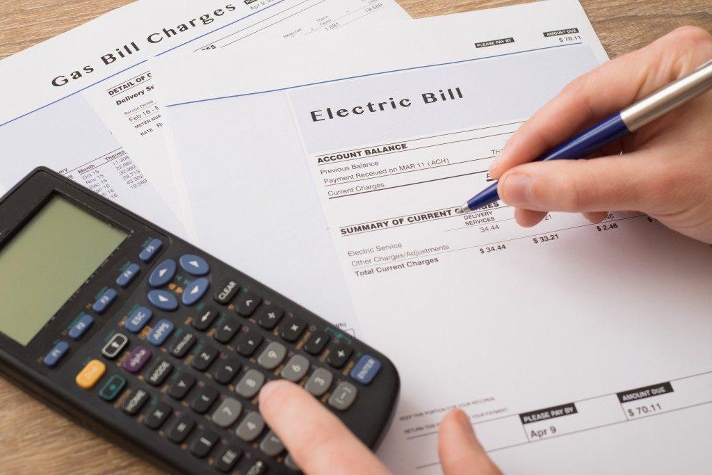 Electric bill copy being written on