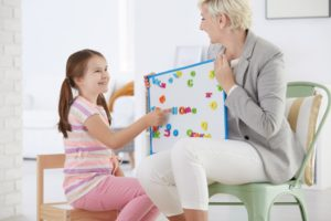 therapist teaching a kid