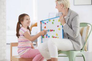 therapist teaching a kid