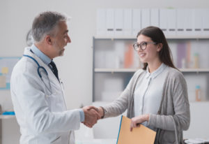 patient consulting to her doctor