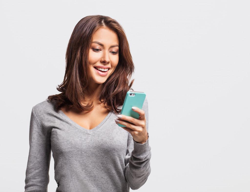 Woman enjoying her phone