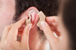 inserting a hearing aid