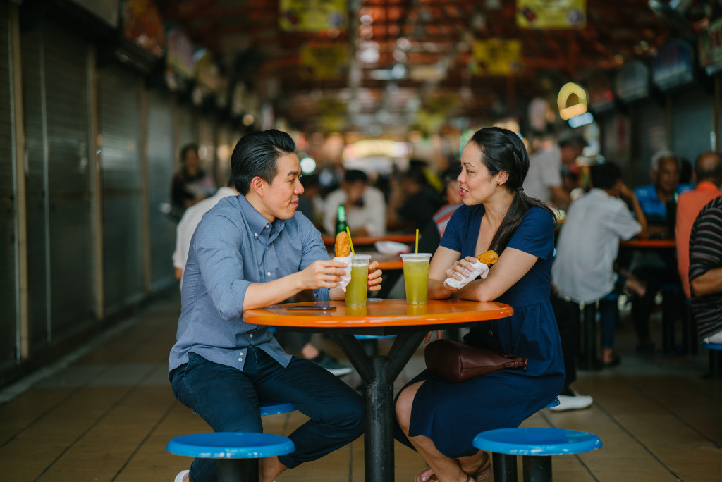 man and woman eating together