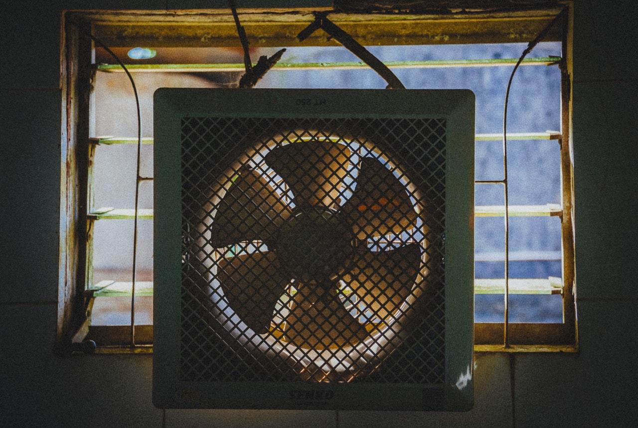 an exhaust fan hanging near a window