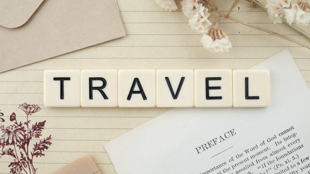 travel spelled with letter tiles