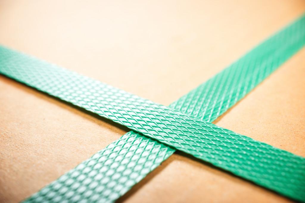 green ribbon on a box