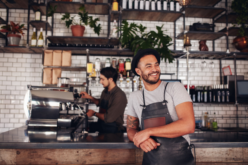 business owner smiling inside his coffee shop